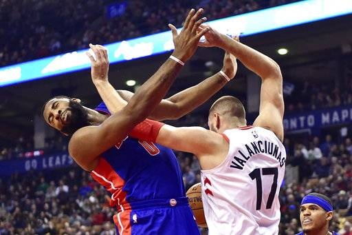 Toronto Raptors center Jonas Valanciunas (17) and Detroit Pistons center Andre Drummond (0) get tangled up under the net battling for a loose ball during the first half of an NBA basketball game in Toronto on Wednesday, Jan. 17, 2018. (Frank Gunn/The Canadian Press via AP)