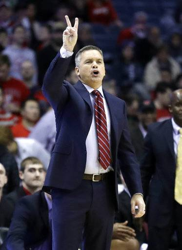 Ohio State head coach Chris Holtmann directs his team during the second half of an NCAA college basketball game against Northwestern Wednesday, Jan. 17, 2018, in Rosemont, Ill. Ohio State won 71-65. (AP Photo/Nam Y. Huh)