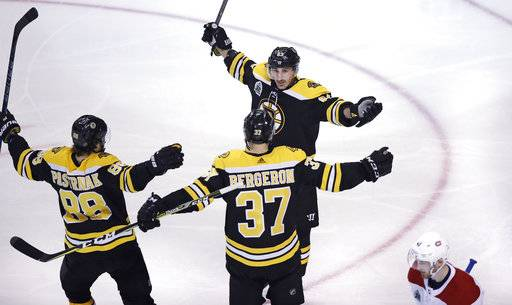 Boston Bruins left wing Brad Marchand, top, celebrates after his goal off Montreal Canadiens goaltender Carey Price (31) during the third period of an NHL hockey game in Boston, Wednesday, Jan. 17, 2018. (AP Photo/Charles Krupa)