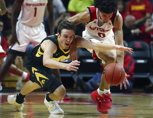 Iowa' Nicholas Baer, left, and Rutgers' Geo Baker (0) battle for a loose ball during an NCAA college basketball game, Wednesday, Jan. 17, 2018 in Piscataway, N.J. (John Munson/NJ Advance Media via AP)