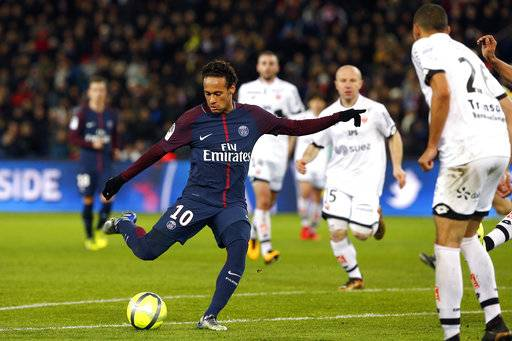 PSG's Neymar shoots the ball to score during his French League One soccer match between Paris-Saint-Germain and Dijon, at the Parc des Princes stadium in Paris, France, Wednesday, Jan.17, 2018. (AP Photo/Thibault Camus)