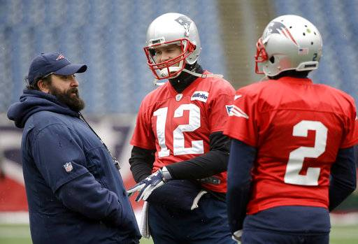 New England Patriots defensive coordinator Matt Patricia, left, speaks with quarterbacks Tom Brady (12) and Brian Hoyer (2) during an NFL football practice, Wednesday, Jan. 17, 2018, at Gillette Stadium, in Foxborough, Mass. (AP Photo/Steven Senne)