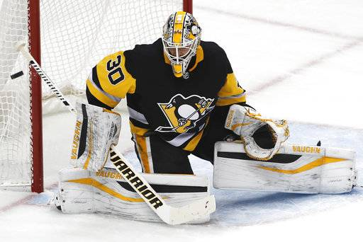 FILE - In this Thursday, Jan. 4, 2018, file photo, Pittsburgh Penguins goaltender Matt Murray blocks a shot during the first period of the team's NHL hockey game against the Carolina Hurricanes in Pittsburgh Murray is taking a leave of absence from the team following the death of his father, the Penguins announced Wednesday, Jan 17, 2018. Murray's father Matt died on Tuesday in Ontario, Canada. (AP Photo/Gene J. Puskar, File)