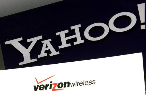FILE - This Monday, July 25, 2016, file photo shows Yahoo and Verizon logos on a laptop, in North Andover, Mass. Verizon is pushing further into sports streaming with a new NBA deal that will let Yahoo users watch some out-of-market games. (AP Photo/Elise Amendola, File)