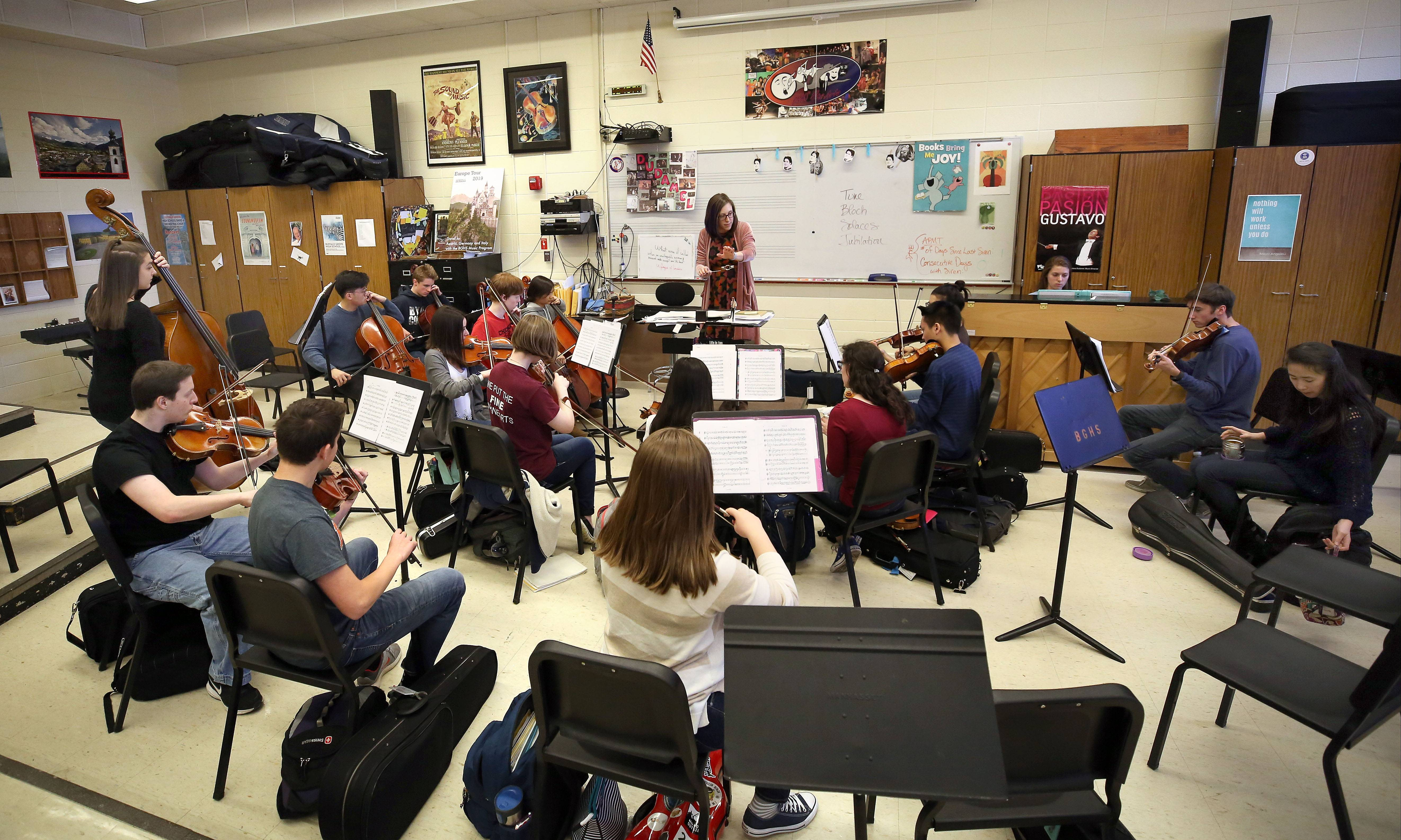 "The Buffalo Grove High School chamber orchestra rehearses Thursday afternoon ahead of their first public performance of ""Solaces,"" a special composition created in honor of three teachers who died last school year."