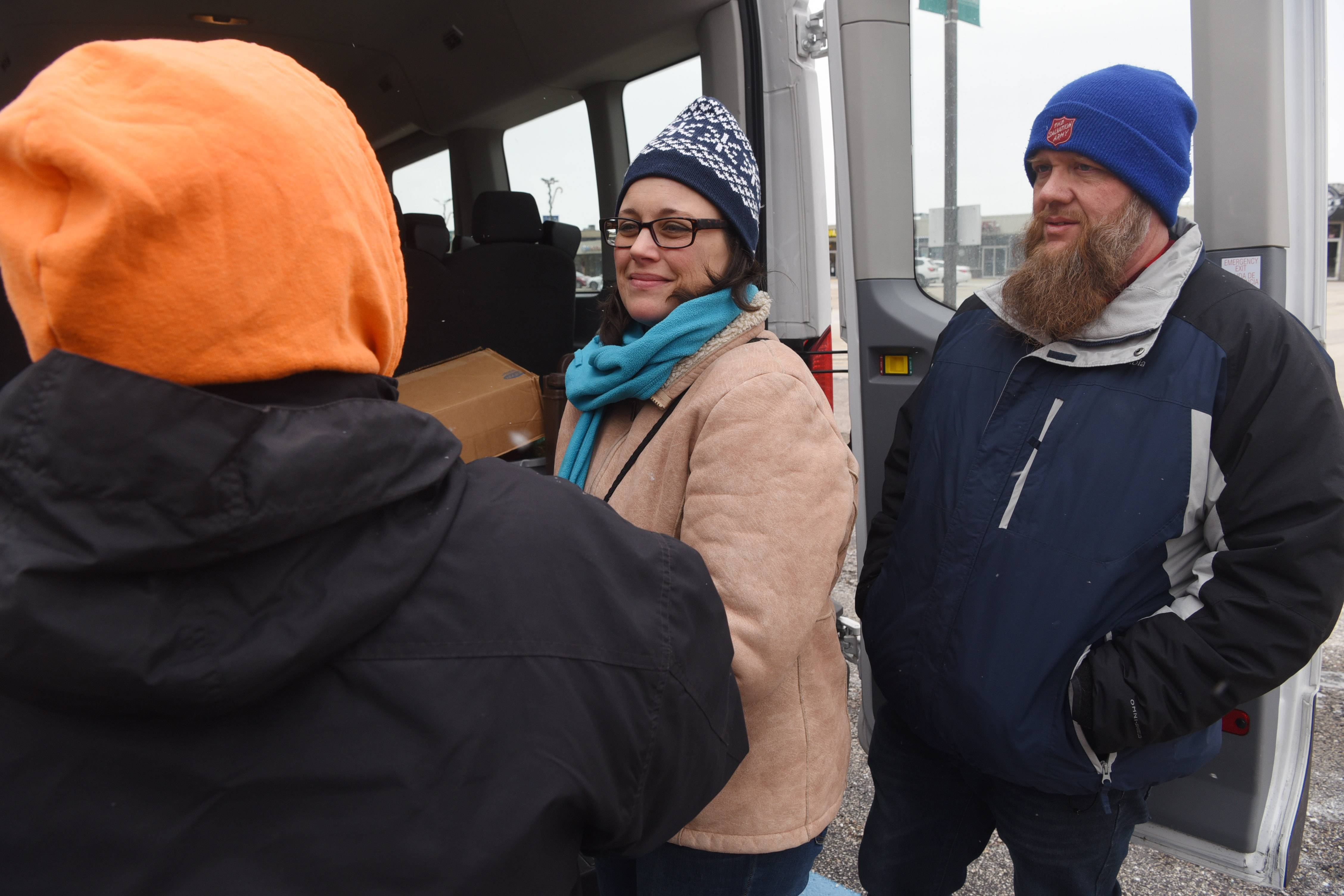 In a ritual repeated every Tuesday and Friday, homeless people come out to meet Bill and Debbi Middendorp and their Salvation Army van. At this stop in Prospect Heights, the couple pass out sandwiches, snacks, water, hygiene products, coats, gloves, blankets and other necessities.