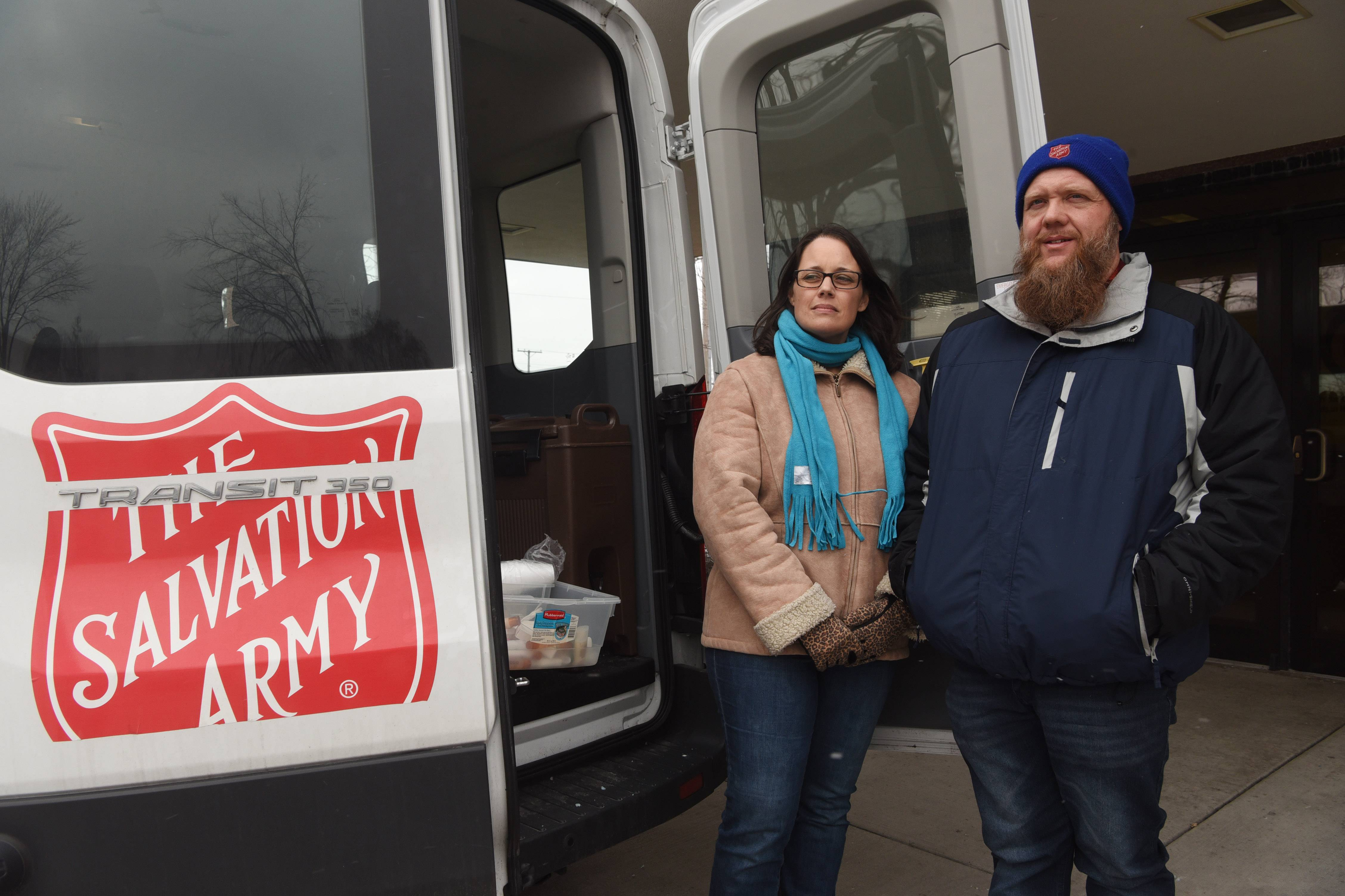 Every Tuesday and Friday, Bill and Debbi Middendorp load a Salvation Army van in Des Plaines with sandwiches, snacks, water and hygiene products and drive around the suburbs to help the homeless.