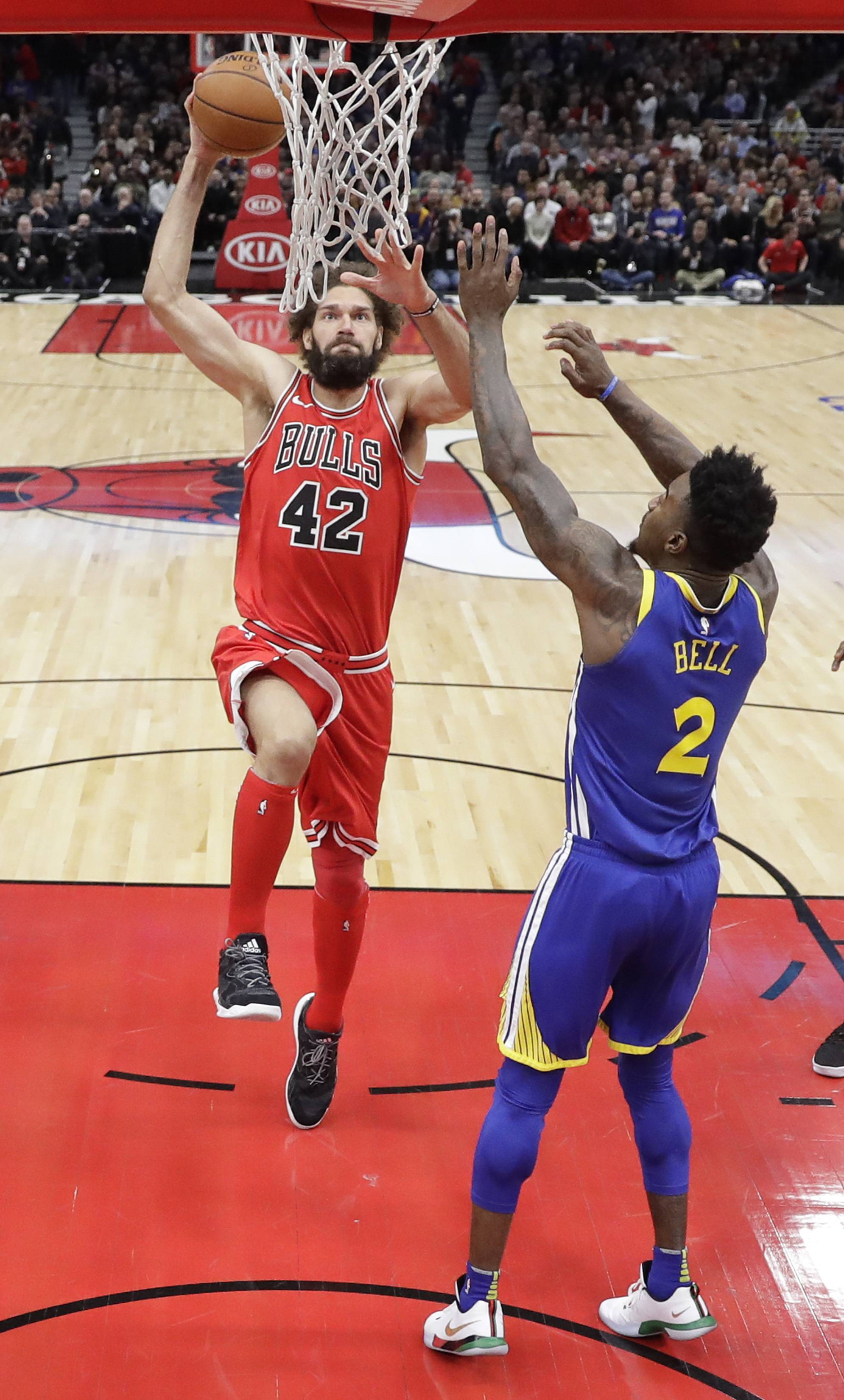 Chicago Bulls center Robin Lopez goes up for a dunk on Golden State Warriors' Jordan Bell.