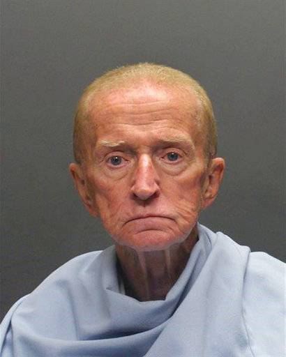 CORRECTS DATE TO JAN. 14 FROM JAN. 15 - This Sunday, Jan. 14, 2018, photo released by the Tucson Police Department shows suspect Robert Francis Krebs, an 80-year-old man they say robbed a credit union at gunpoint. Police announced Sunday that a tip led to the arrest of Krebs after police circulated surveillance photos of him entering the Pyramid Credit Union and at a teller's window. They say Krebs had a handgun, demanded money from the teller and was given cash before running out of the bank. (Tucson Police Department via AP)