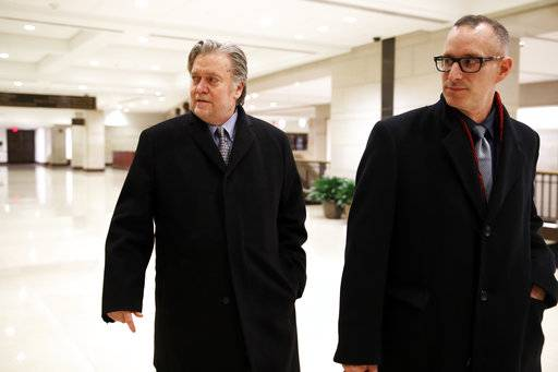Former White House strategist Steve Bannon, left, leaves a House Intelligence Committee meeting where he was interviewed behind closed doors on Capitol Hill, Tuesday, Jan. 16, 2018, in Washington. (AP Photo/Jacquelyn Martin)