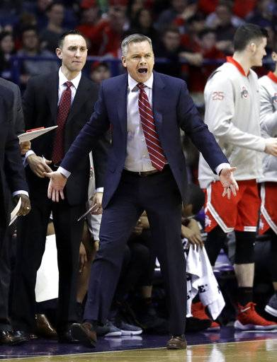Ohio State head coach Chris Holtmann yells his team during the second half of an NCAA college basketball game against Northwestern Wednesday, Jan. 17, 2018, in Rosemont, Ill. Ohio State won 71-65.
