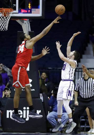 Ohio State forward Kaleb Wesson, left, blocks a shot by Northwestern guard Bryant McIntosh during the first half of an NCAA college basketball game Wednesday, Jan. 17, 2018, in Rosemont, Ill.