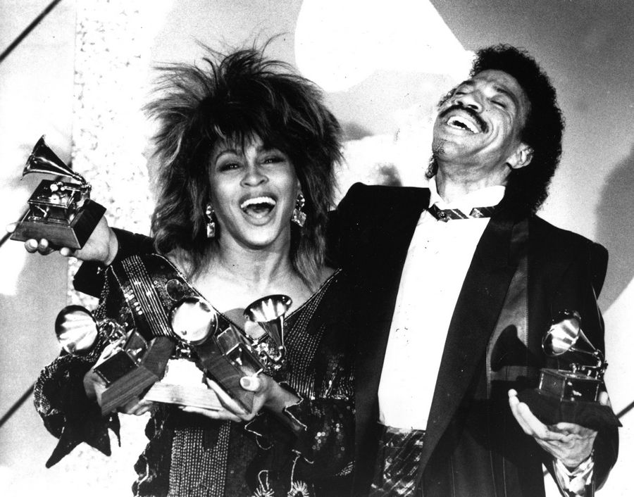 "Tina Turner, left, and Lionel Richie pose with a total of five awards between them at the Grammy Awards show in Los Angeles in 1985. Richie won Album of the Year for ""Can't Slow Down."""