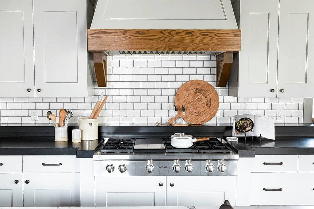"This kitchen by Studio McGee features standard subway tile with a darker grout. Subway tile is a go-to because it pairs easily with so many different styles, designer Shea McGee says. ""It's also really easy to change the grout color or tile layout to shake things up."""
