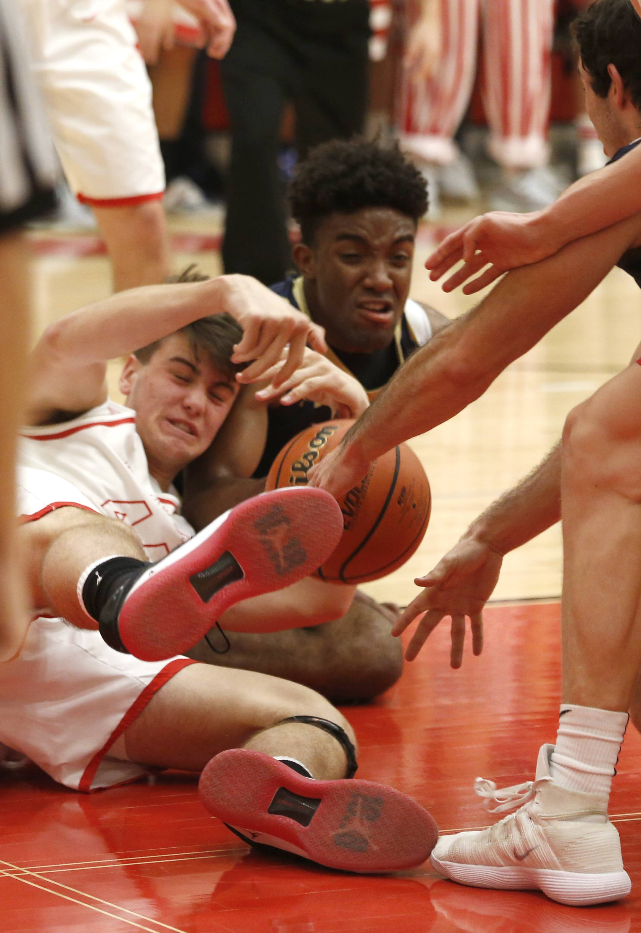 Timothy Christian's Nick Huisman, left, fights for a loose ball with IC Catholic Prep's Khali Saunders, right.