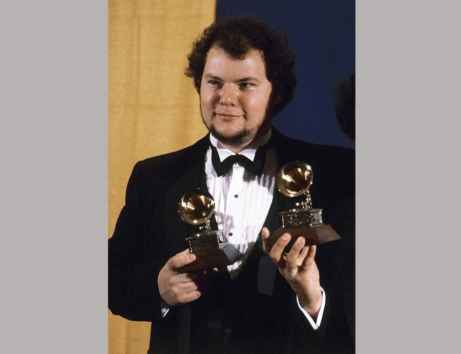 Christopher Cross holds the Grammy Award for album of the year for his self-titled album. Cross beat out Barbra Streisand, Billy Joel, Frank Sinatra and Pink Floyd.