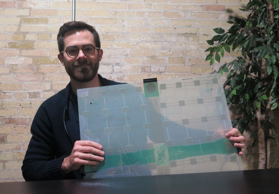 Scanalytics co-founder and CEO Joe Scanlin holds a smart floor sensor his company creates that track people's movements in Milwaukee. The sensors are among the tools retailers are using to gain insights on consumer habits.