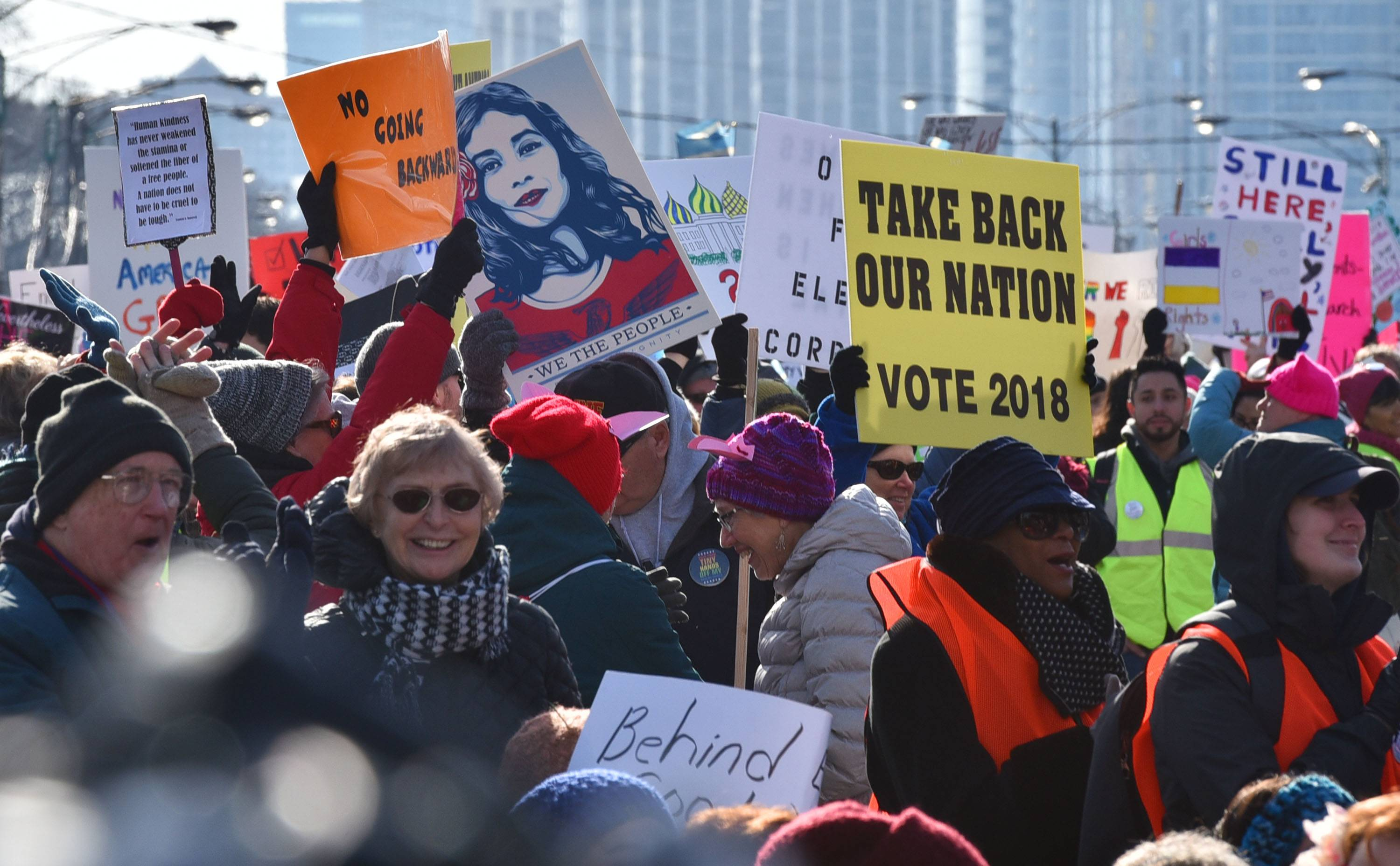 The crowd held signs with a common theme at the Women's March Chicago in Grant Park Saturday.