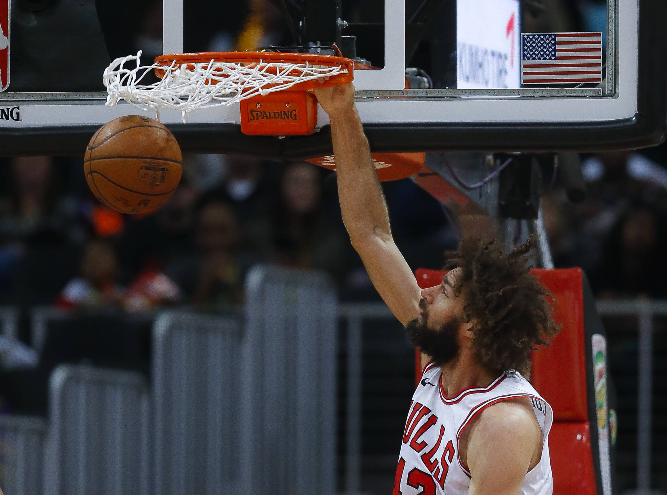 The Bulls pounded the ball inside with success on Saturday as Robin Lopez, above, scored 20 points and Lauri Markkanen had 6 dunks in a 113-97 victory at Atlanta. The Bulls matched a season-high with 31 assists.