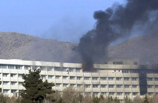 5 killed as gunmen battle security forces at Kabul hotel
