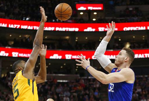 Utah Jazz forward Derrick Favors, left, goes up for a block against Los Angeles Clippers forward Blake Griffin (32) in the first half during an NBA basketball game Saturday, Jan. 20, 2018, in Salt Lake City.