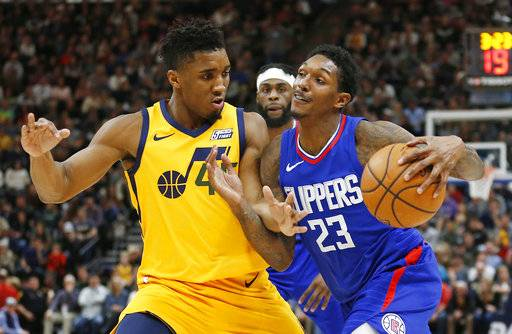 Utah Jazz guard Donovan Mitchell, left, guards Los Angeles Clippers guard Lou Williams (23) in the first half during an NBA basketball game Saturday, Jan. 20, 2018, in Salt Lake City.