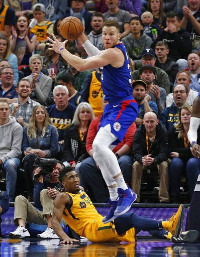 LosAngeles Clippers forward Blake Griffin, right, grabs a rebound as Utah Jazz guard Donovan Mitchell, rear, looks on in the first half during an NBA basketball game Saturday, Jan. 20, 2018, in Salt Lake City.