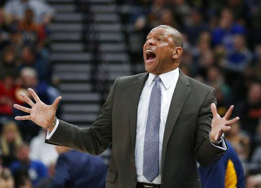 Los Angeles Clippers head coach Doc Rivers reacts after a foul in the first half during an NBA basketball game against the Utah Jazz, Saturday, Jan. 20, 2018, in Salt Lake City.