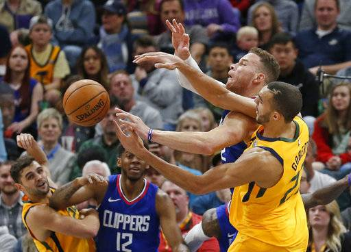 Utah Jazz center Rudy Gobert (27)and Los Angeles Clippers forward Blake Griffin, right rear, battle for the ball in the first half during an NBA basketball game Saturday, Jan. 20, 2018, in Salt Lake City.