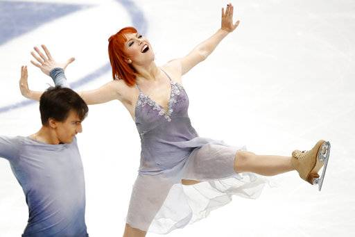 Russia's Tiffani Zagorski and Jonathan Guerreiro perform in the pairs ice dance free dance event at the European figure skating championships in Moscow, Russia, Saturday, Jan. 20, 2018.