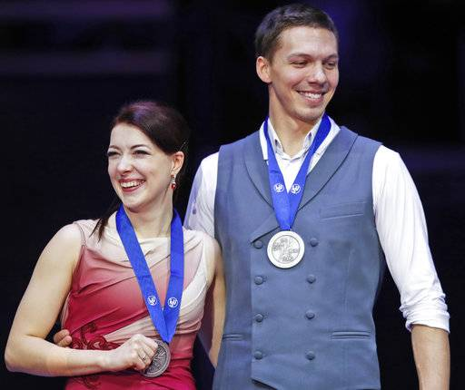 Russia's Ekaterina Bobrova and Dmitri Soloviev pose with their silver medals after the pairs ice dance free dance event at the European figure skating championships in Moscow, Russia, Saturday, Jan. 20, 2018.