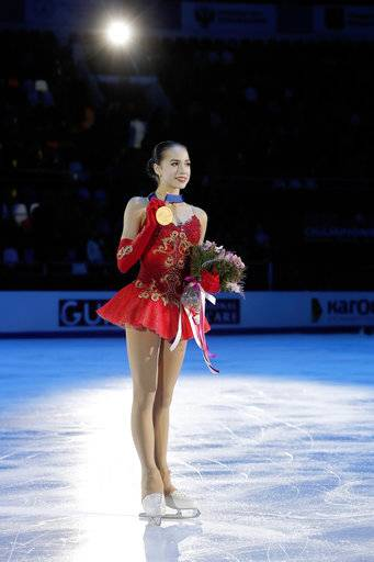 Russia's Alina Zagitova shows her gold medal after winning the ladies free skating event at the European figure skating championships in Moscow, Russia, Saturday, Jan. 20, 2018.