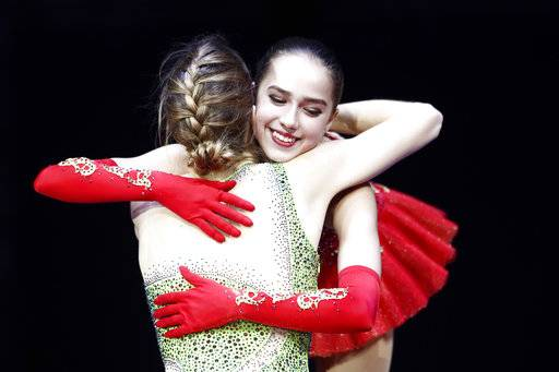Gold medallist Alina Zagitova of Russia, right, is hugged by Italy's bronze medallist Carolina Kostner after the ladies free skating event at the European figure skating championships in Moscow, Russia, Saturday, Jan. 20, 2018.