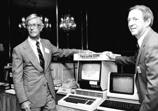 CORRECTS THAT COLEMAN IS AT RIGHT, NOT LEFT - In this July 30, 1981 photo,  John Coleman, weather channel founder, right, and Frank Batten, publisher of the Norfolk, Va., Virginian-Pilot and Ledger-Star, and chairman and chief executive of Landmark Communications, Inc., are seen during a news conference in New York. John Coleman, the founder of The Weather Channel and longtime KUSI weatherman, died Saturdaty night, Jan. 20, 2018, at home in Las Vegas, said his wife Linda Coleman. He was 83.