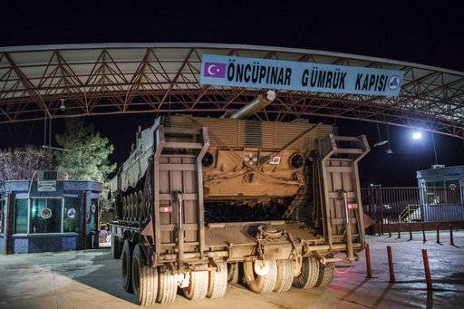 The Latest: Turkey's Erdogan warns Kurds not to protest