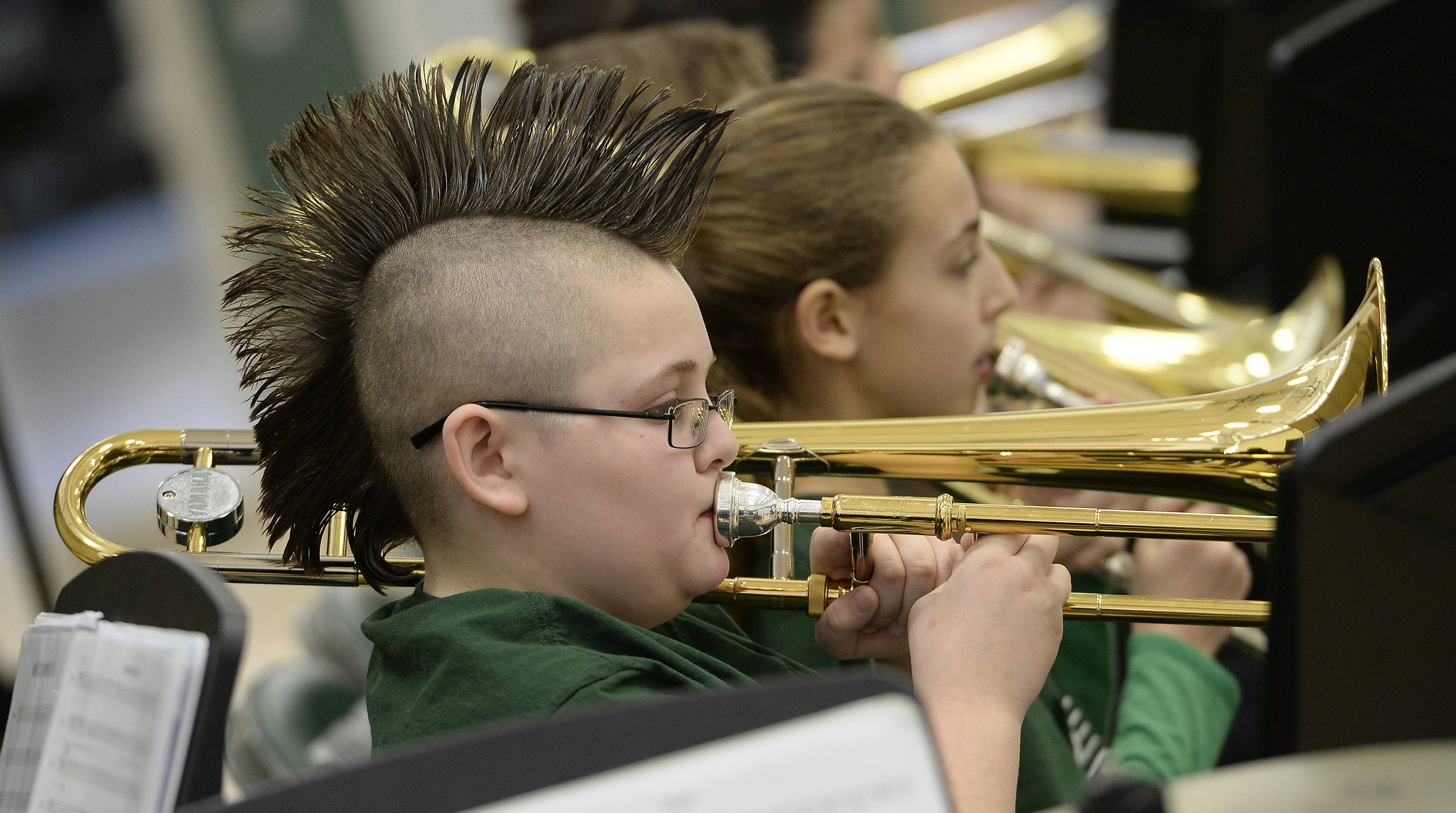 Vito Romanos, 11, of Round Lake belts out the notes with the rest of his trombone playing band members of Fremont school in Mundelein at the 21st annual Jazz Jamboree at Thomas Middle School in Arlington Heights on Saturday.