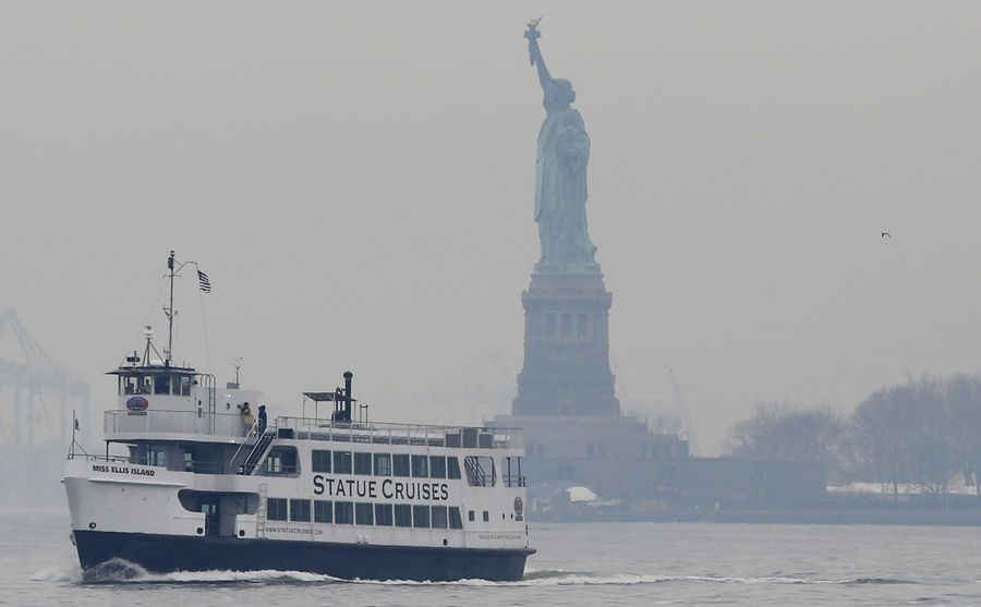 A Statue of Liberty and Ellis Island tour boat passes by the Statue of Liberty after dropping passengers off there, Monday, Jan. 22, 2018, in New York, after resuming service early Monday during the government shutdown. The Statue of Liberty and Ellis Island opened for visitors Monday, with New York state picking up the tab for the federal workers.
