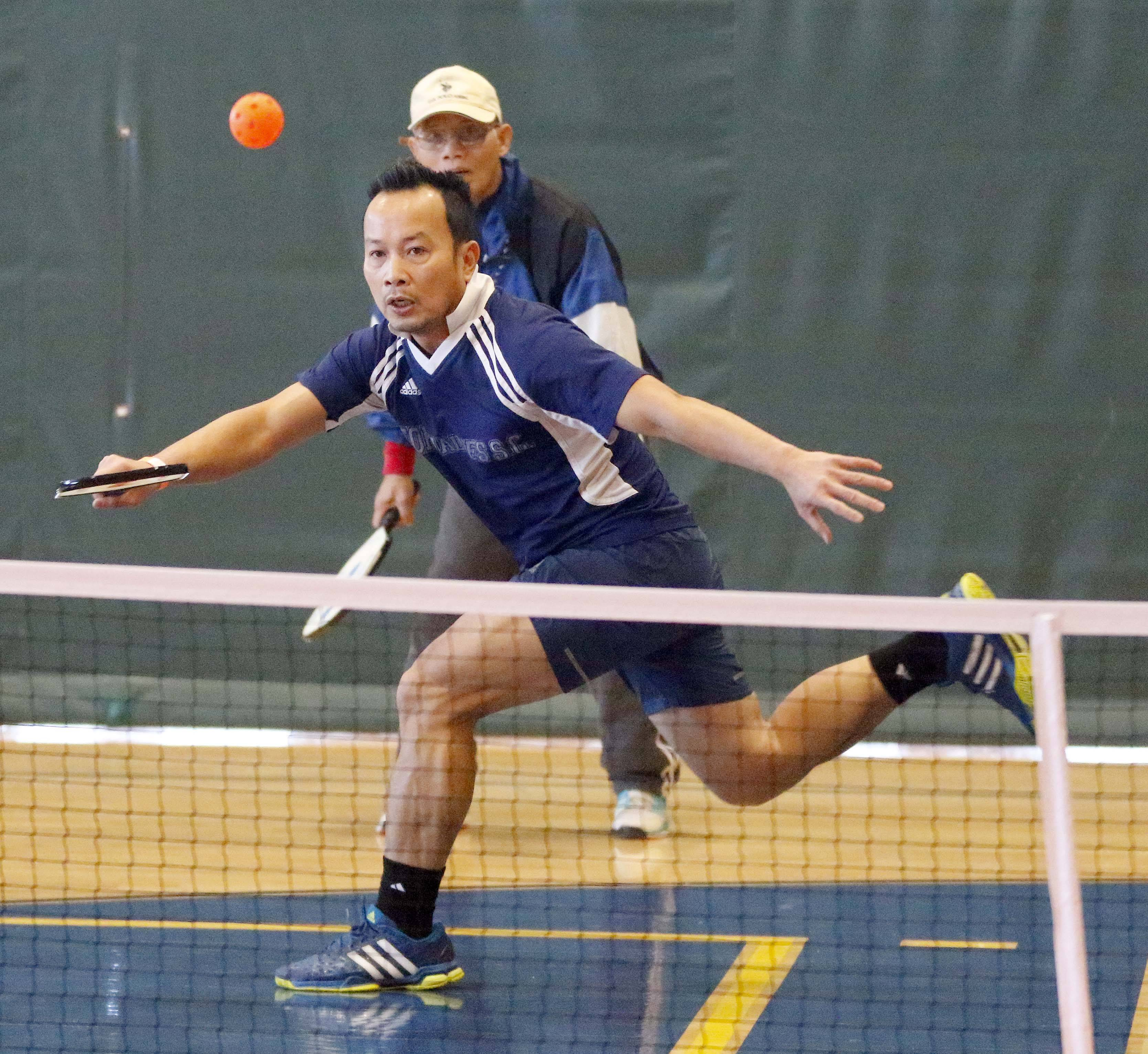 Keo Soundara of Elgin returns a shot during a pickleball class offered in Elgin that is helping to bridge a cultural gap with Elgin's Lao population.