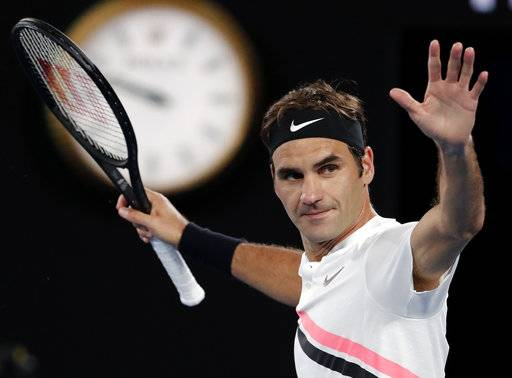 Switzerland's Roger Federer celebrates after defeating Tomas Berdych of the Czech Republic in their quarterfinal at the Australian Open tennis championships in Melbourne, Australia, Wednesday, Jan. 24, 2018.