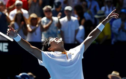 South Korea's Chung Hyeon celebrates after defeating United States' Tennys Sandgren in their quarterfinal at the Australian Open tennis championships in Melbourne, Australia, Wednesday, Jan. 24, 2018.