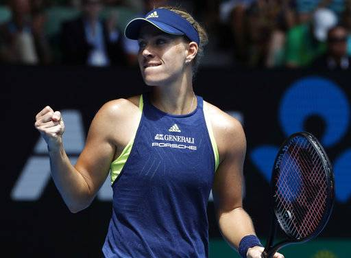 Germany's Angelique Kerber celebrates after defeating United States' Madison Keys in their quarterfinal at the Australian Open tennis championships in Melbourne, Australia, Wednesday, Jan. 24, 2018.