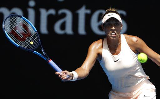 United States' Madison Keys makes a forehand return to Germany's Angelique Kerber during their quarterfinal at the Australian Open tennis championships in Melbourne, Australia, Wednesday, Jan. 24, 2018.