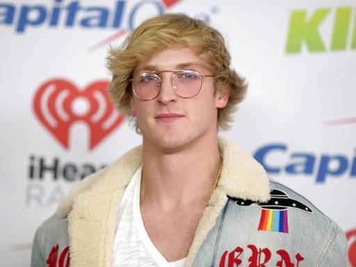"FILE - In this Dec. 1, 2017 file photo, YouTube personality Logan Paul arrives at Jingle Ball in Inglewood, Calif. Paul has returned to YouTube with a 7-minute suicide prevention video he hopes will ""make a difference in the world.� He was suspended by YouTube after posting video of him in a forest in Japan near what seemed to be a body hanging from a tree. The location is known in Japan as a frequent site for suicides. (Photo by Richard Shotwell/Invision/AP, File)"