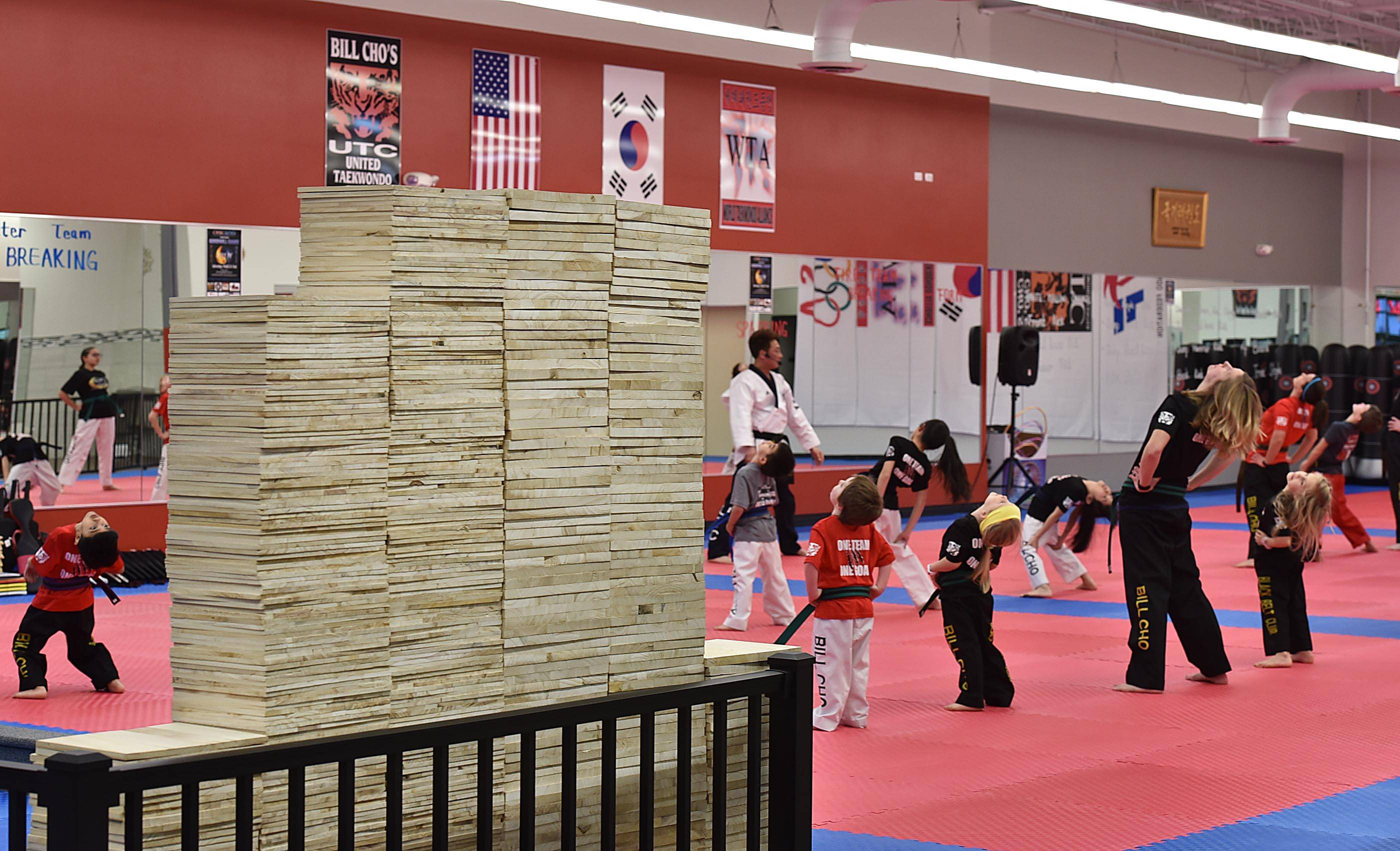 Stacks of boards 6 feet tall wait to be broken during a fundraiser at Bill Cho's United Tae Kwon Do in South Elgin to benefit the police department. Students will break boards and the public is invited to purchase and break a board.