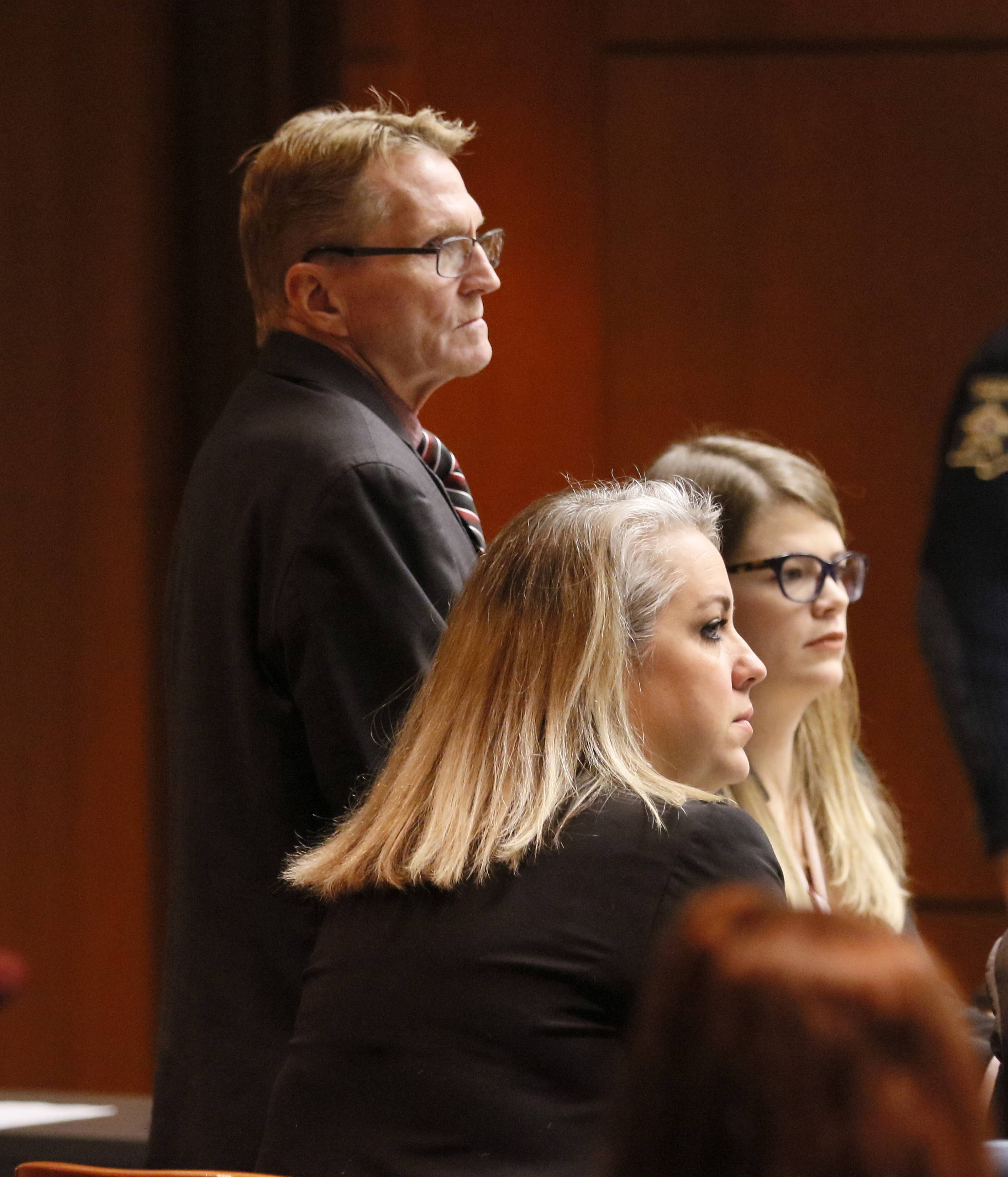 William Amor and his attorneys, Lauren Kaeseberg and Lauren Myerscough-Mueller, listen to Assistant State's Attorney Thomas Minser's opening statement Wednesday at the DuPage County Courthouse. Amor is on trial for first-degree murder and arson in the 1995 death of his mother-in-law in Naperville.