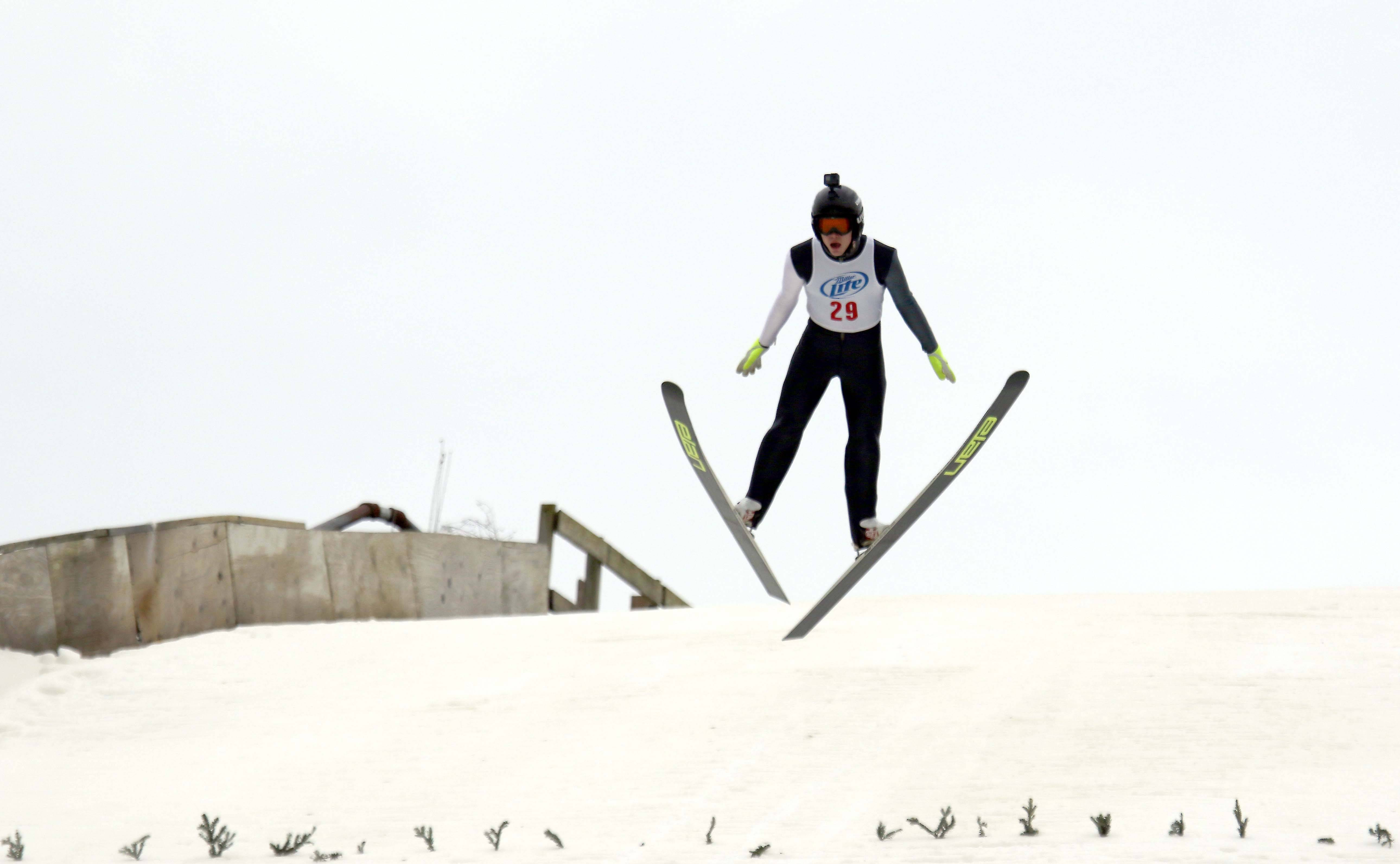 Hunter Gibson, 15, of Fox River Grove, a member of the Norge Ski Club, launches himself from the big hill during the club's 112th International Winter Tournament in Fox River Grove. Ski jumpers take to the slopes for this year's tournament this weekend.