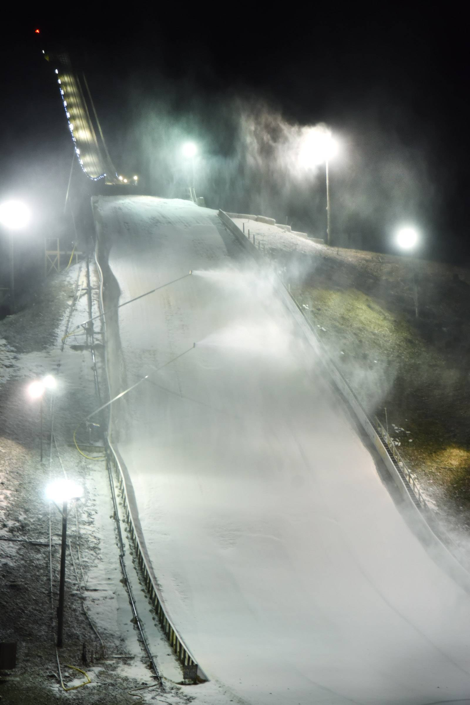 Several snow-making machines work to cover the surface of the 70-meter hill at the Norge Ski Jump in preparation for last year's International Winter Tournament in Fox River Grove. About 50 professional jumpers from Finland, Norway, Slovenia and the U.S. are set to compete this Saturday and Sunday.
