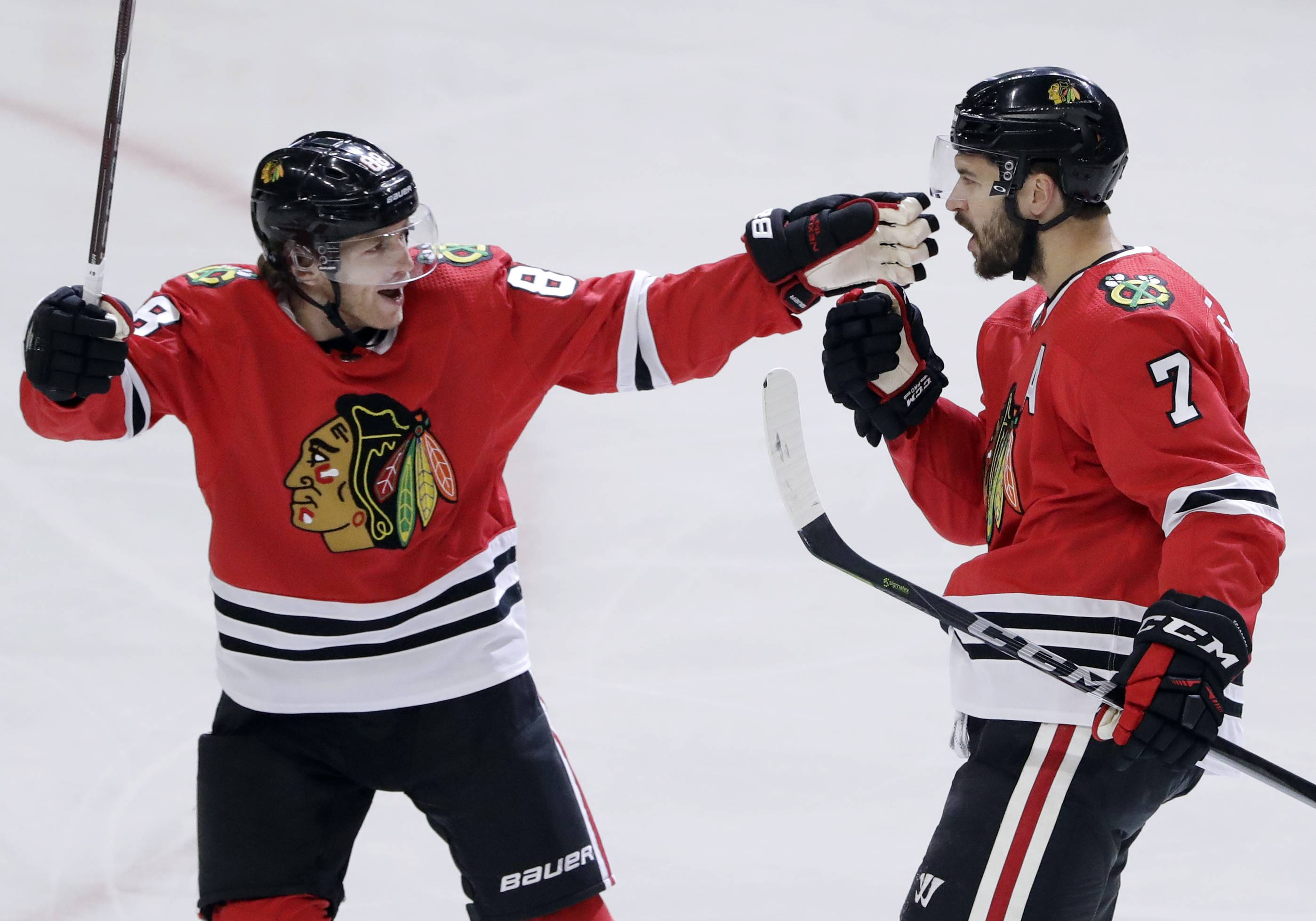 Defenseman Brent Seabrook, right, celebrates with right wing Patrick Kane after scoring against the Toronto Maple Leafs during the first period on Wednesday. In an effort to cure the ills of their dismal power play, the Hawks bounced ideas off each other after practice Tuesday. The Hawks went 2-for-4 on the power play in their 3-2 overtime loss the Leafs on Wednesday.