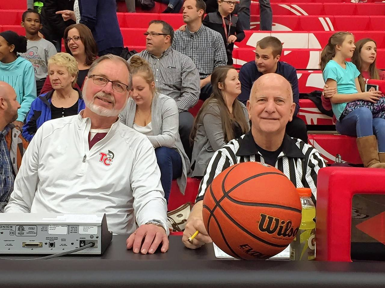 Partners at Timothy Christian's basketball scorer's table for 50 years and friends since kindergarten, Ken Huizinga (left) and George Bosman were honored for their achievement at the Elmhurst school before Tuesday's boys basketball game against Wheaton Academy.