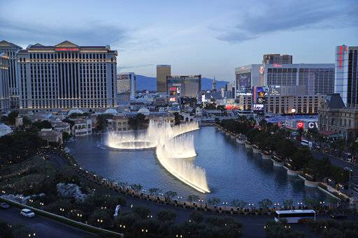 File - In this April 4, 2017, file photo, the fountains of Bellagio erupt along the Las Vegas Strip in Las Vegas. The union representing hotel workers in Las Vegas will ask casino-resort operators to give every housekeeper a 'panic button' as part of their new contracts. Leaders of the Culinary Union will bring the request to the bargaining table next month on behalf of 14,000 housekeepers who work on the Las Vegas Strip and the destination's downtown area. The push comes amid the #MeToo movement against sexual assault and harassment and is in line with ordinances recently approved in other cities. (AP Photo/John Locher, File)